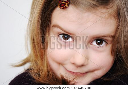 Adorable curious little girl making silly funny faces isolated on white background