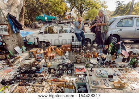 TBILISI, GEORGIA - OCT 9, 2016: Traders of flea market having a lot of vintage cameras souvenirs toys and retro staff for the customers on October 9, 2016. Tbilisi has a population of 1.5 million people