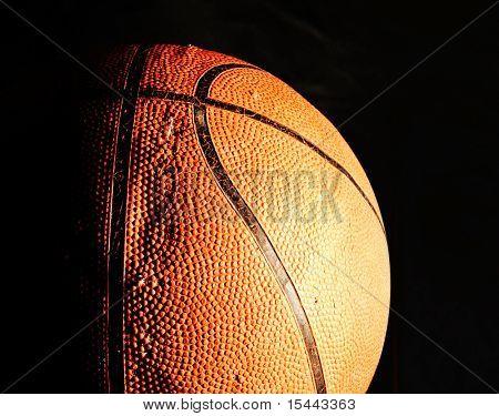 Old basketball ball in dark