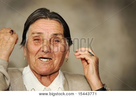 Portrait of mature woman speaking with expressions, grimaces and gestures