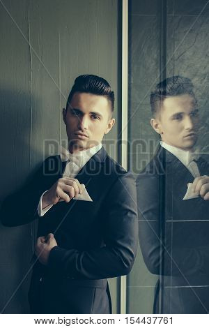 Man In Suit Touches Handkerchief