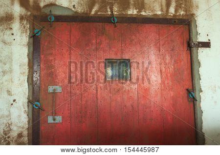 Closeup of old red wooden door , dirty door