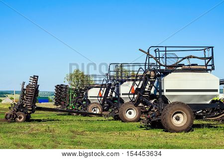 Sowing machine with seeding and plowing tools