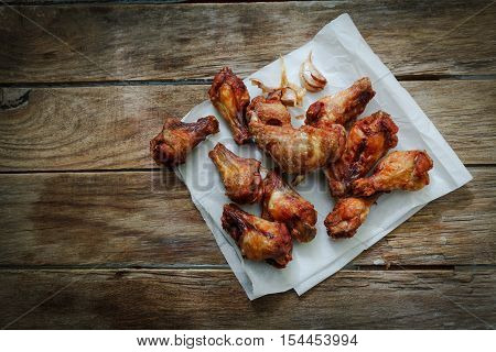 deep fried chicken wings on fryer with garlic