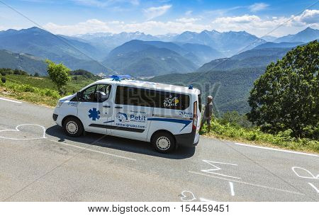 Col D'AspinFrance- July 152015: The offiical ambulance driving on the road to Col D'Aspin in Pyrenees Mountains during the stage 11 of Le Tour de France 2015.