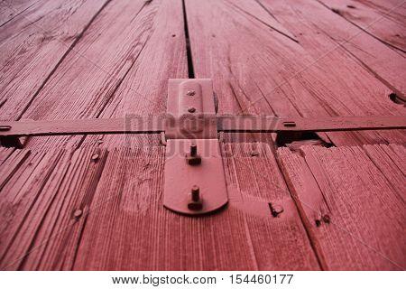 A wooden red barn door in Sleeping Bear Dunes National Lakeshore, Michigan