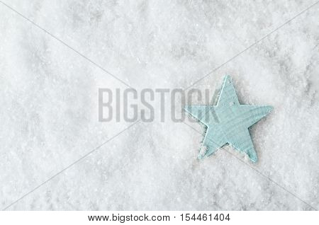 Pale Blue Star On White Snow From Above