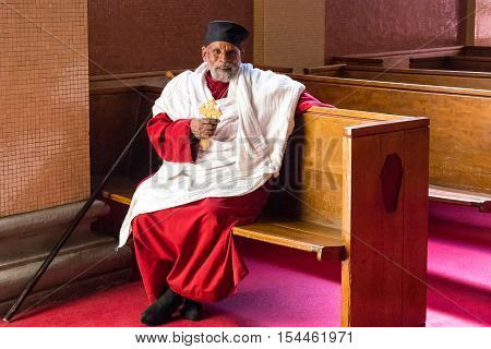 Addis Ababa Ethiopia - January 14 2016: An old priest sitting in the Cathedral of the Holy Trinity