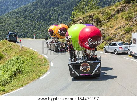 Col D'AspinFrance- July 15 2015: Senseo Caravan during the passing of the Publicity Caravan on the Col d'Aspin in Pyerenees Mountains in the stage 11 of Le Tour de France 2015. Senseo is a registered trademark for a coffee brewing system.