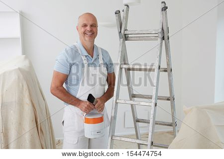 Portrait Of Decorator Painting Room In House
