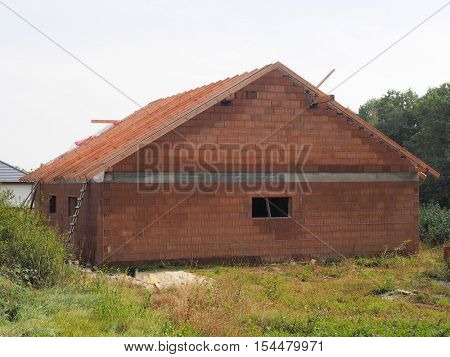 Unfinished house of air brick and wooden roof