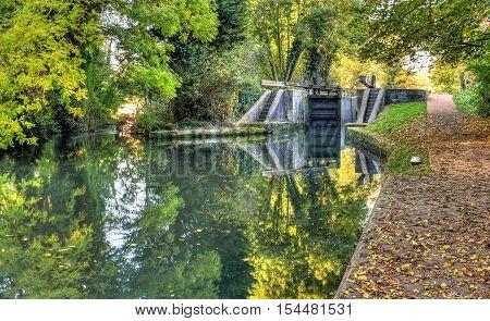 British autumn scene. Lock on the canal
