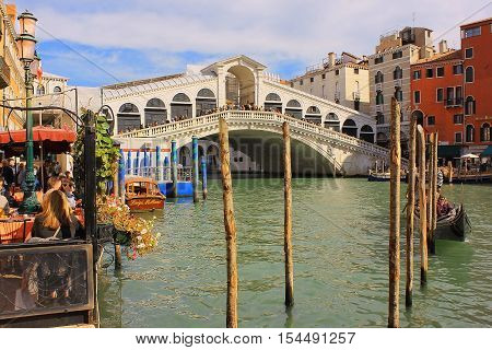VENICE, ITALY - 11 OCTOBER 2016: Rialto Bridge, oldest bridge across the Grand Canal of Venice October 11 2016