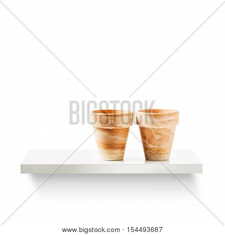 Two clay flower pots on shelf isolated on white background. Garden equipment. Group of objects with clipping path