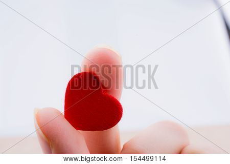 Little Red Color Heart Shape In Hand