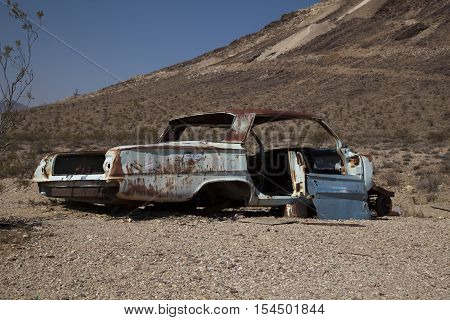 Rhyolite Nevada USA - August 24 2016: An abandoned car at the ghost town of Rhyolite
