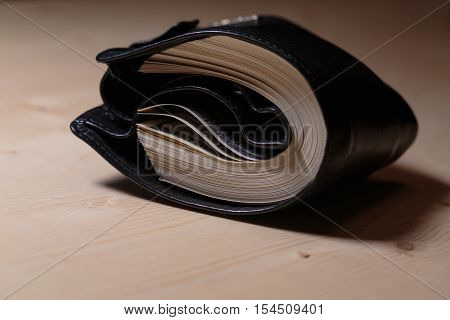 Wallet full of cash. Cash flow of dollars in wallet