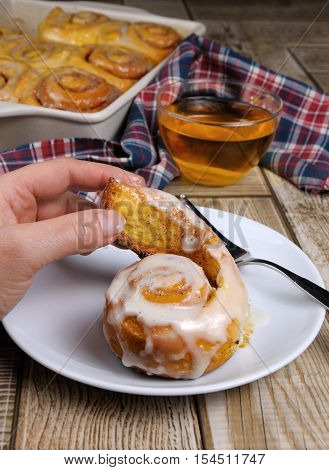 bun of pumpkin with cinnamon in the form of snails in a creamy glaze
