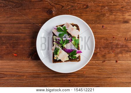 Smorrebrod - danish open sandwich with fish herring cheese