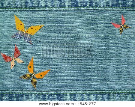 Blaue Jeans Hintergrund mit Schmetterlingen von rags