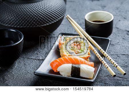 Fresh Sushi Served In A Black Ceramic