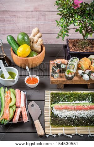 Table with ingredients for sushi on old wooden table