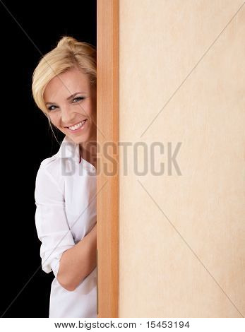 Beautiful Woman Looks Out Of The Doorway