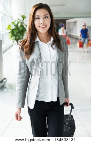 beautiful asian young girl with luggage in airport