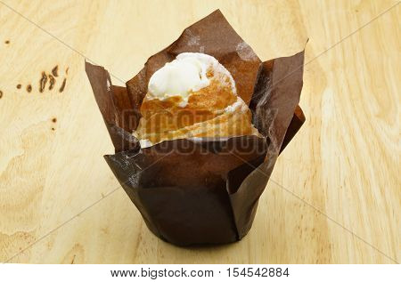 Closeup of cruffin creme brulee on a wood background