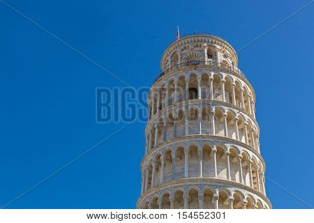 PISA, ITALY - SEPTEMBER 2016 : Closeup world famous Leaning Tower of Pisa (Torre pendente di Pisa), freestanding bell tower campanile of cathedral in Pisa, Italy on September 22, 2016.