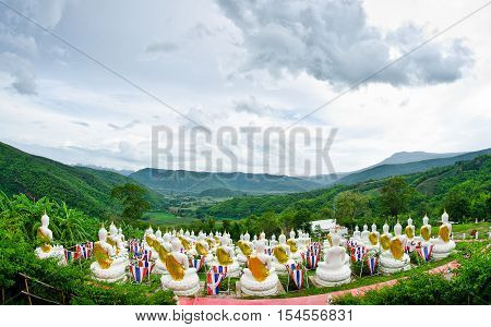 White buddha statue in the Valley back buddha statue buddha statue live in Nam Nao District :Phetchabun Province Thailand.have space words