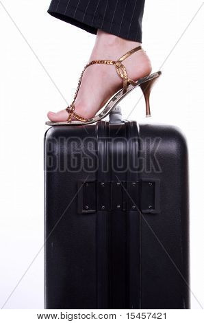 foot on suitcase