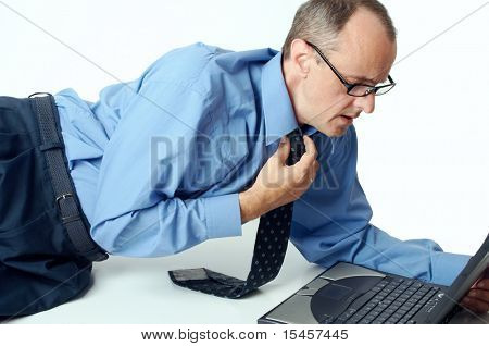 experience business man looking at laptop