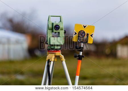 Surveying equipment: total station and geodesic landmark.