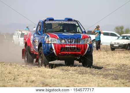 Speeding Red And Blue Toyota Nissan Single Cab Rally Car Front View