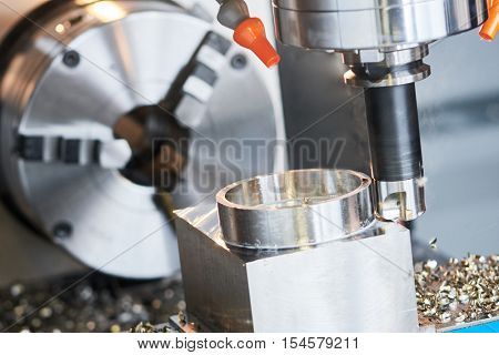 Milling metalworking process. Industrial precision CNC metal machining by vertical cutting mill