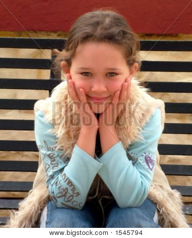 Young Girl On A Park Bench