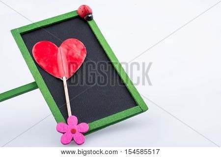 Heart shape icon placed on a noticeboard