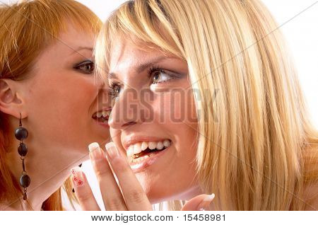 two girls talking about somebody