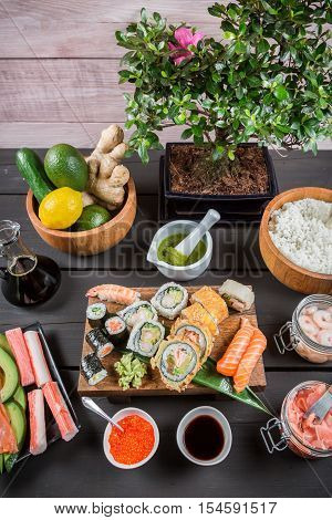 Sushi with fresh ingredients on old wooden table