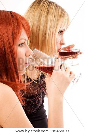 two girl friends drinking on a party