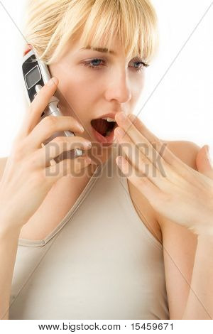 young blond woman speaking secrets on the cell phone