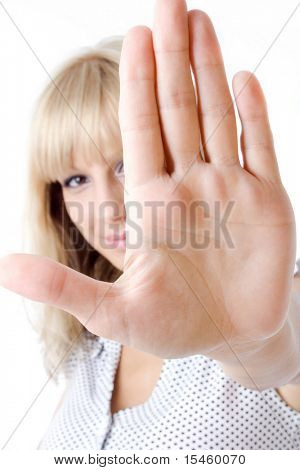 woman with hand in front of her face gesturing stop