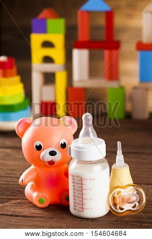 Colorful children toys on wooden background