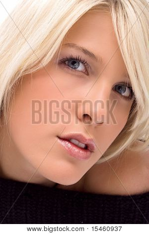 blond young woman portrait, studio shot