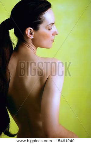 woman portrait from back side, bare back