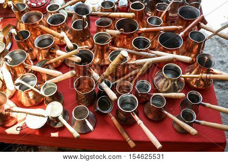 Selling old metal cookware in a market place