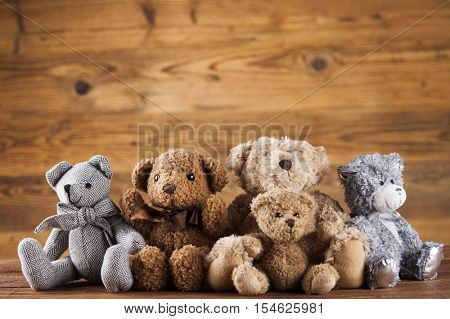Teddy bears on on vintage wooden background