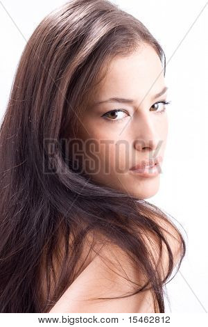 beautiful woman looking over shoulder, studio shot