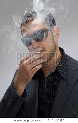 man with cigarette, studio shot